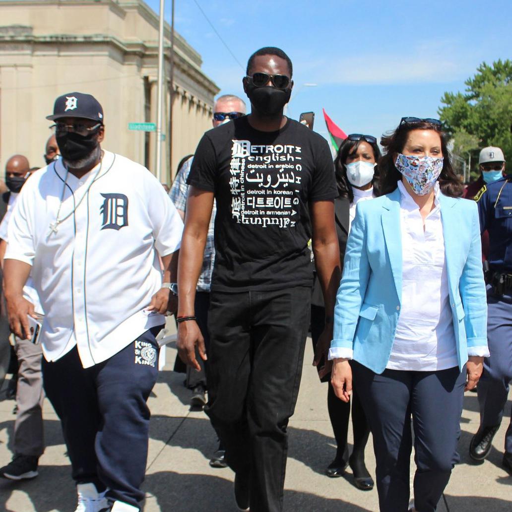 garlin gilchrist walking with gretchen whitmer at protest