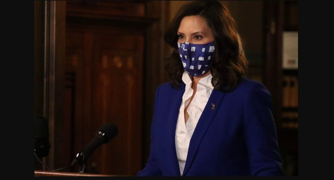 gretchen whitmer giving press conference